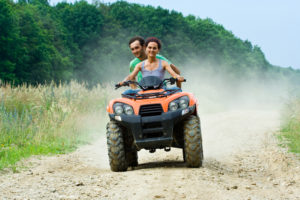 Couple Riding ATV - How to Avoid Kids While on Vacation in Hawaii